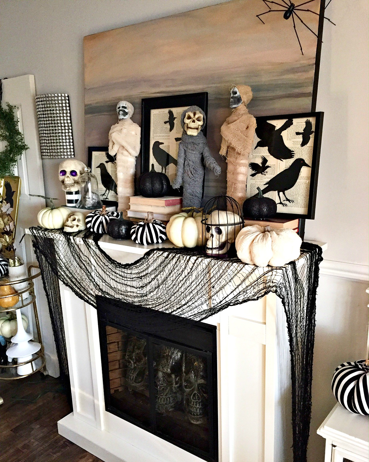 halloween mantel with mummys pumpkins and ravens see all the details at apurdylittlehouse - Halloween Mantle