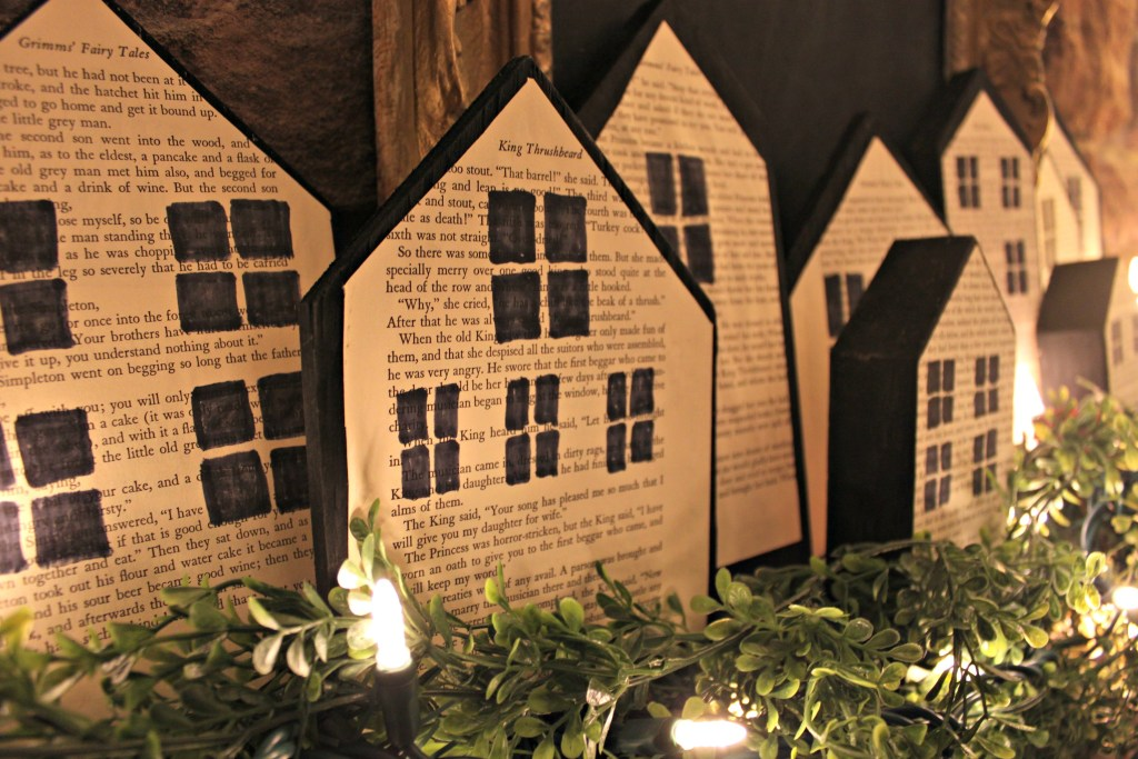 These DIY Christmas wood block houses are a quick and easy craft that anyone can make using some scrap wood and book pages at apurdylittlehouse.com