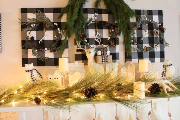 Christmas Home Tour Fireplace Mantel. I used cheap canvas' from the dollar store to create these buffalo check accents over my fireplace at apurdylittlehouse.com
