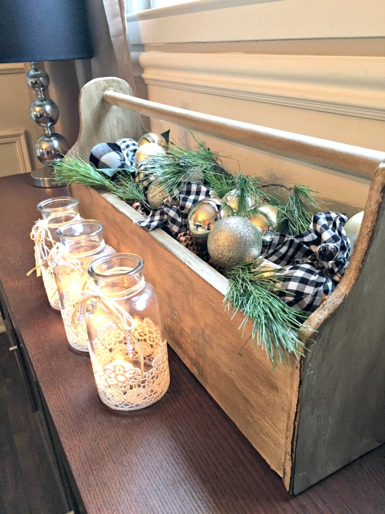 Christmas Home Tour featuring a Vintage Toolbox Christmas display with ornaments, pinecones and green tree clippings at apurdylittlehouse.com