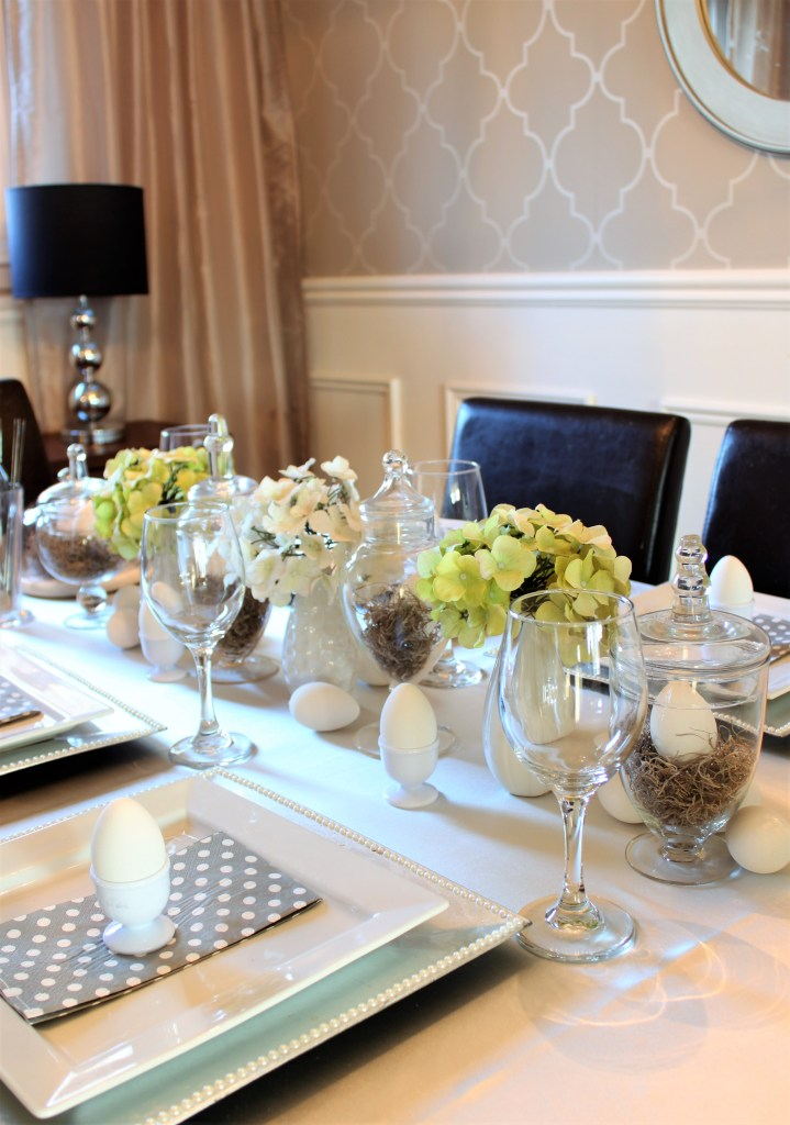 Easter Table Setting Using Thrift Store Apothecary Jars and faux eggs at apurdylittlehouse.com