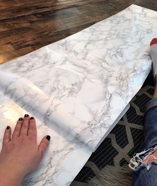 Living Room Built ins around a white electric fireplace. Check out all the how to steps including this counter covered in marble contact paper.