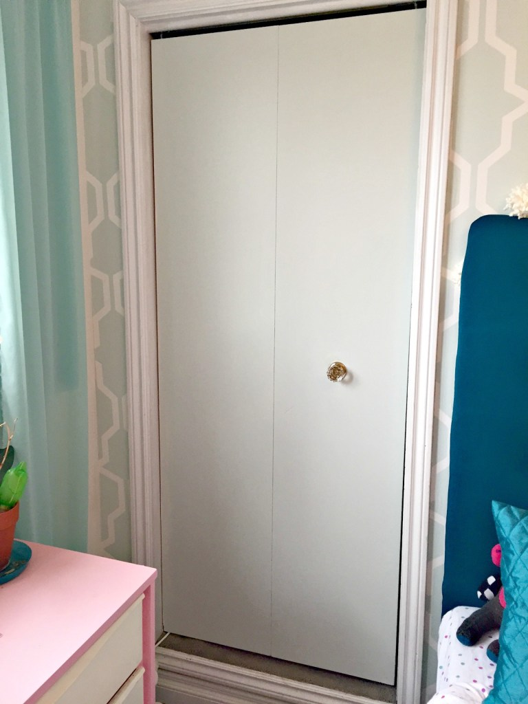 Closet Door Makeover using trim and paint at apurdylittlehouse.com