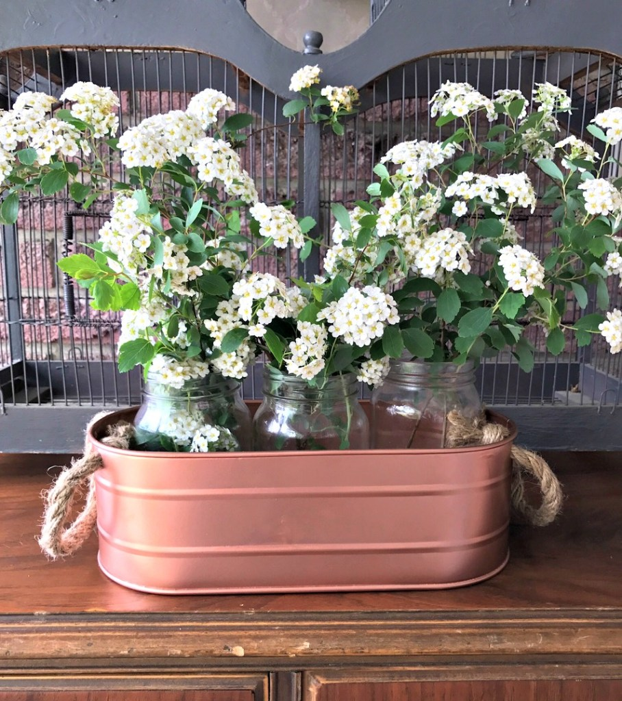 DIY Copper Planter from a galvanized steel bucketand mason jars from the dollar store at apurdylittlehouse.com