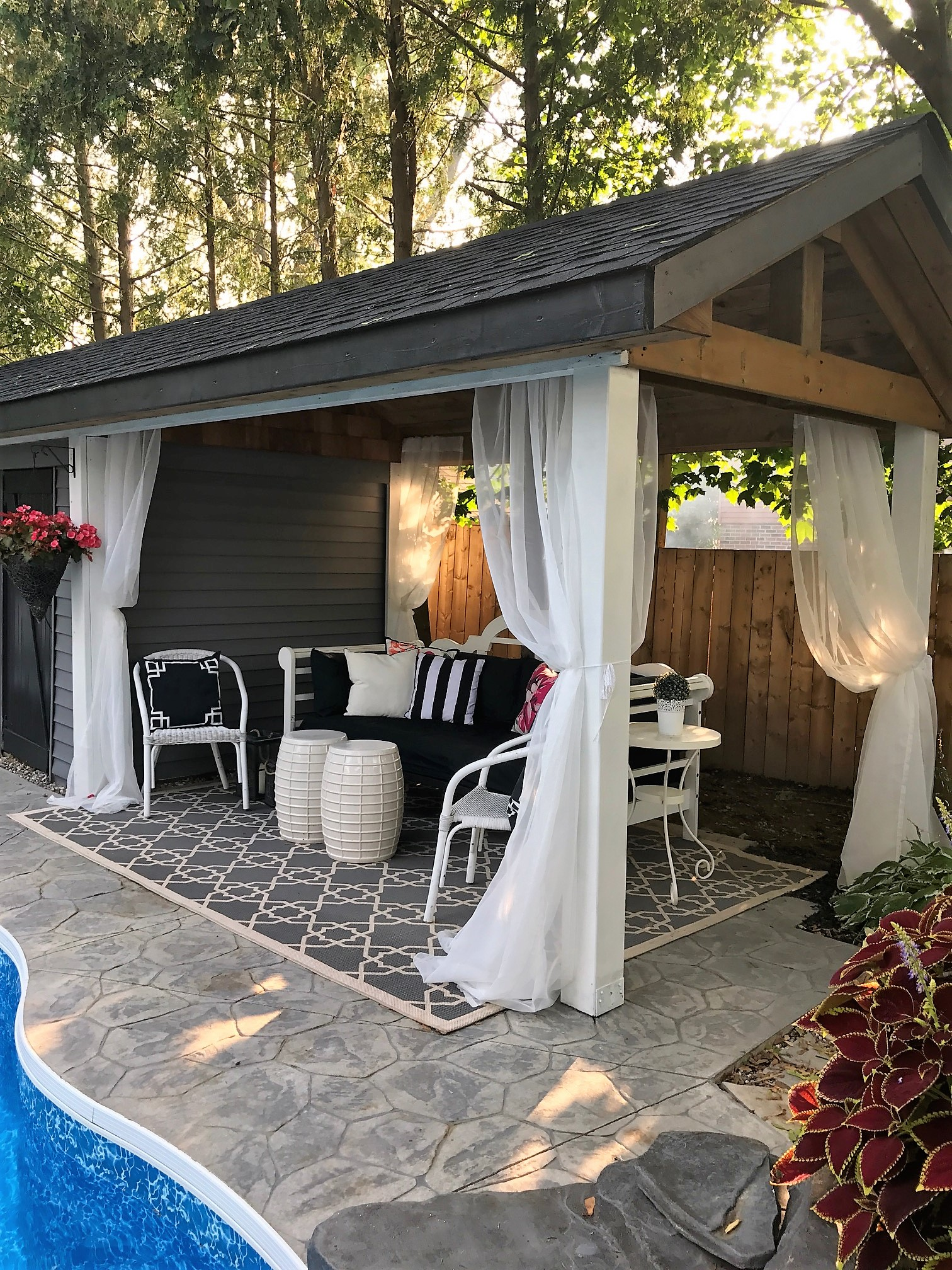 pool cabana furnished with thrift store finds a purdy little house
