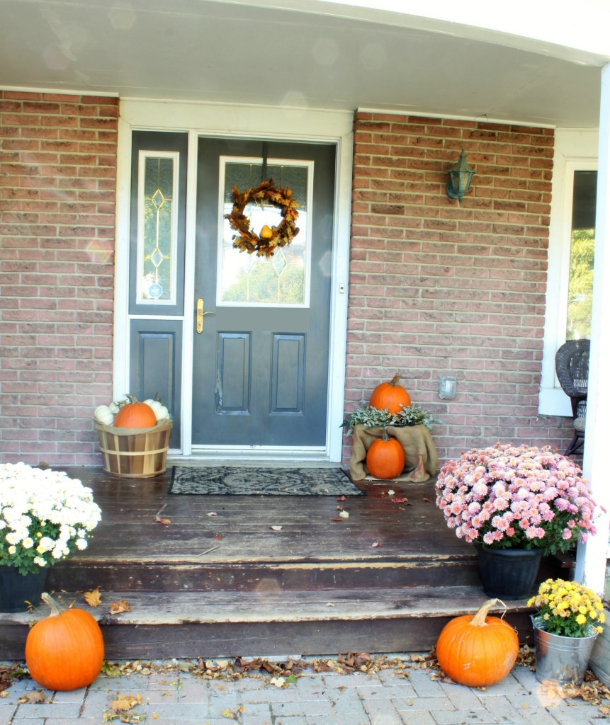 Fall Front Porch decorated with warm Autumn tones, plaid and artwork