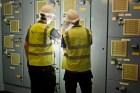 Men in work wear next to vents