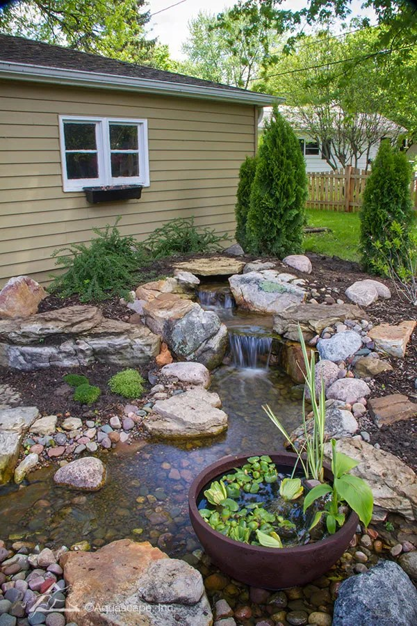 Choosing the Perfect Water Feature for Your Yard ... on Front Yard Waterfall Ideas id=63047