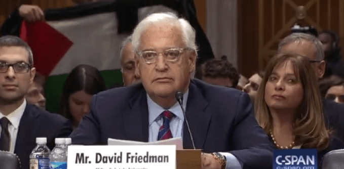 Protesters Continuously Disrupt Friedman Hearing