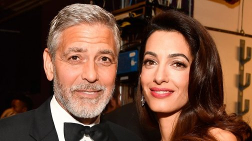 Amal Clooney Carries Twins Alexander and Ella around NYC