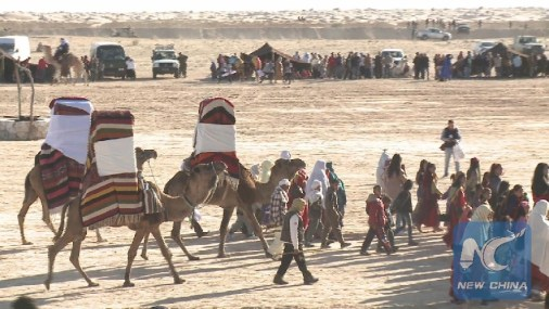 """Feature: Tunisian Small Town Attracts Flocks of Tourists with """"Exotic"""" Desert Festival"""