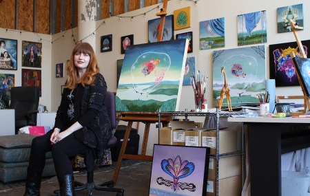 Arabella Proffer sitting in her Ohio art studio