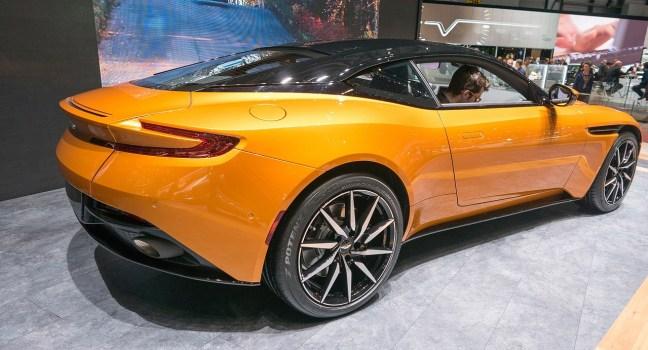 man driving an Aston Martin