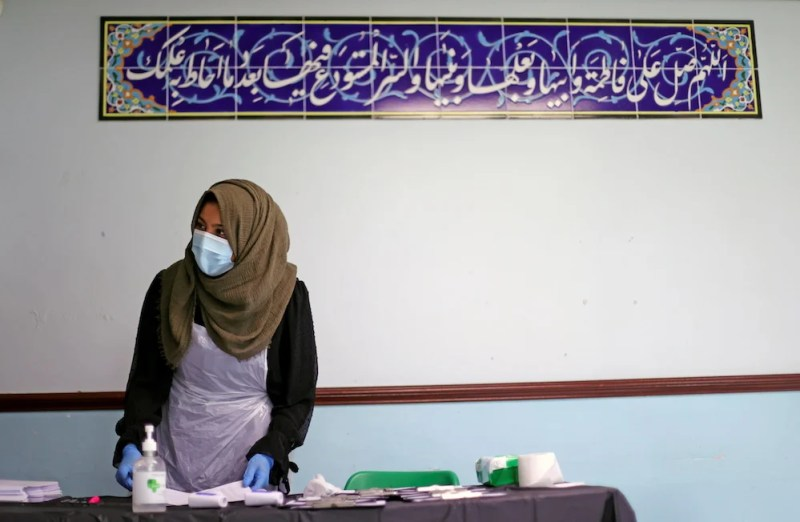 A member of the medical staff works at a coronavirus disease (COVID-19) vaccination centre, at the Al-Abbas Islamic Centre, in Balsall Heath, Birmingham, Britain, January 21, 2021. (Reuters)