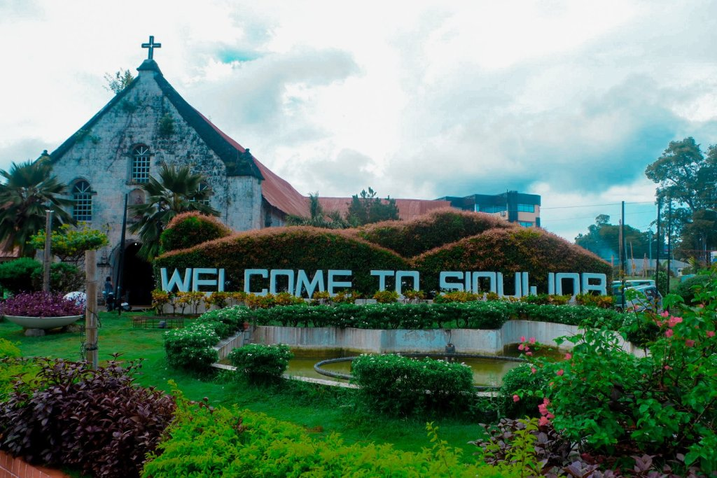 """ALT=""""siquijor travel guide and its welcome signage"""""""