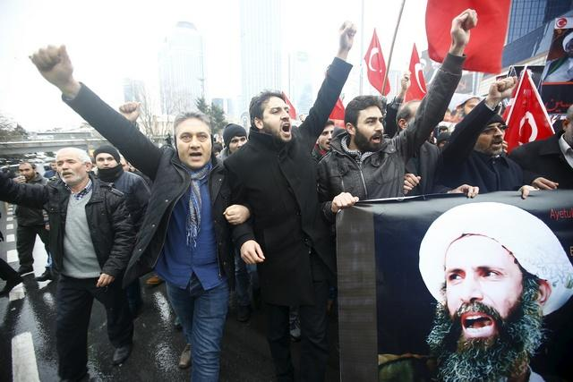 Protesters carry posters of Sheikh Nimr al-Nimr during a demonstration in front of Saudi Arabia's Consulate in Istanbul, Turkey, January 3, 2016. © 2016 Reuters.