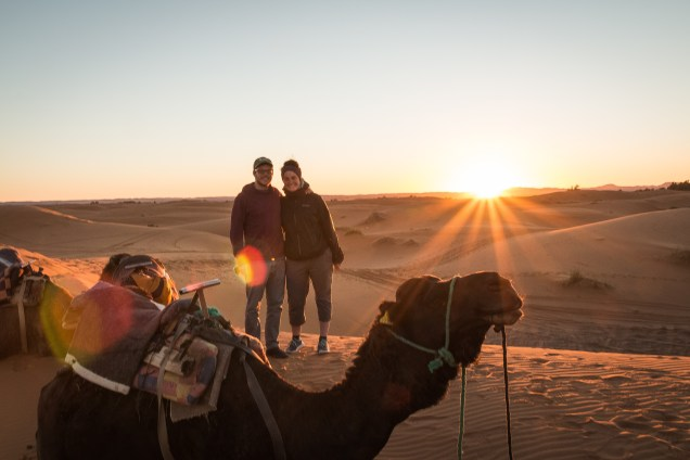 camel at sunset, couple with camel, Riding camels in Morocco, arboursabroad