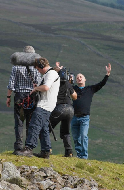 Tony Robinson, filming a piece to camera at Rise Hill.