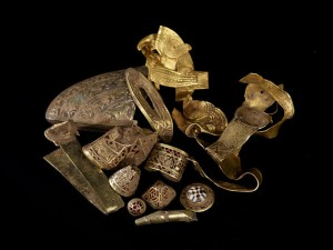 Some of the hoard's most famous components - including the helmet cheekpiece, folded cross, and inscription - photographed shortly after their discovery in 2009. Photo: Portable Antiquities Scheme