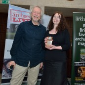 Marion Dowd receives her award for Book of the Year 2016 from Julian Richards. Photo: Aerial-Cam / Current Archaeology