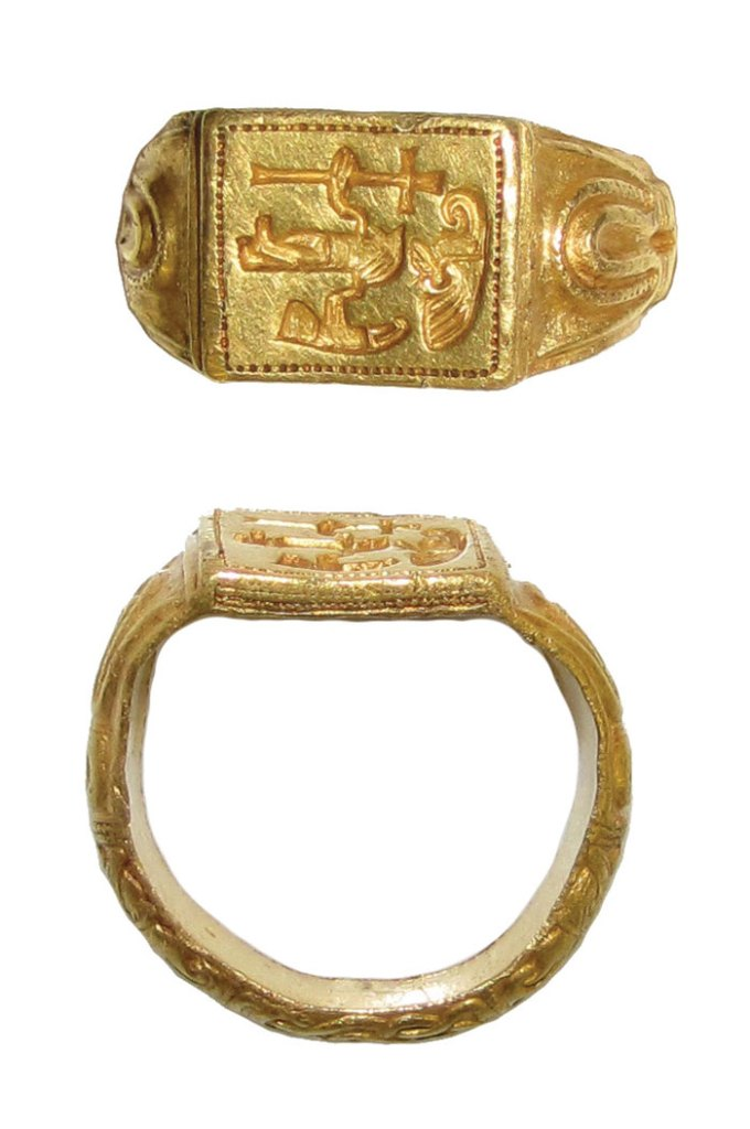 The gold North-West Essex ring is engraved with a human figure, a cross, and two birds (perhaps related to Odin), possibly combining Norse and Christian imagery.