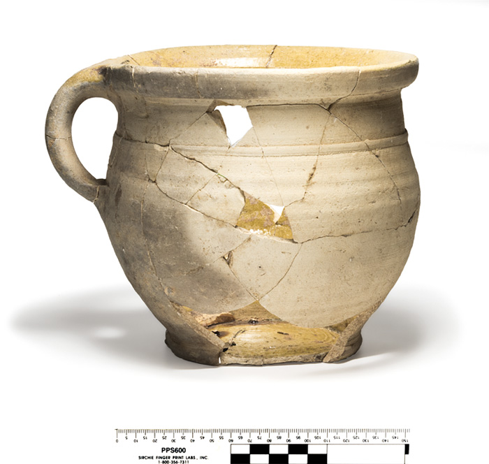 A near-complete chamber pot in yellow-glazed Border Ware (mid-16th/ 17th century).