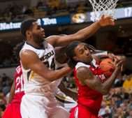 Kevin Puryear attempts to block Cat Barber in Mizzou's 73-59 loss against NC State on Saturday, Dec. 19, 2015. The Tigers dropped to 5-5 on the year.