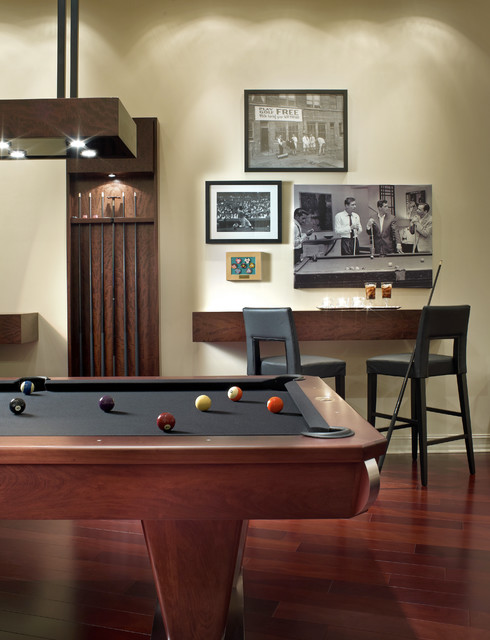 The clearance needed to house a pool table and the space necessary to use the cue to tap. Classy and Charming: 19 Game Room Designs With Pool Table