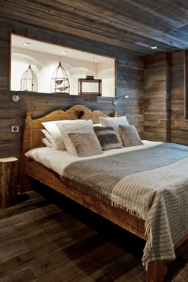 Wall sconces and a romantic wrought iron chandelier illuminate the space and highlight a simple sign that reads 'i love us.'. 15 Restful Rustic Bedroom Interior Designs That Will Make
