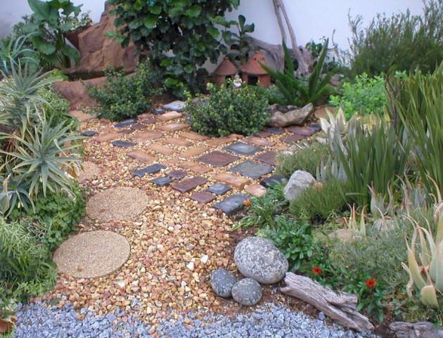 16 Engrossing Pebble Decoration Ideas To Enhance The Look ... on Backyard Pebble Ideas id=43963