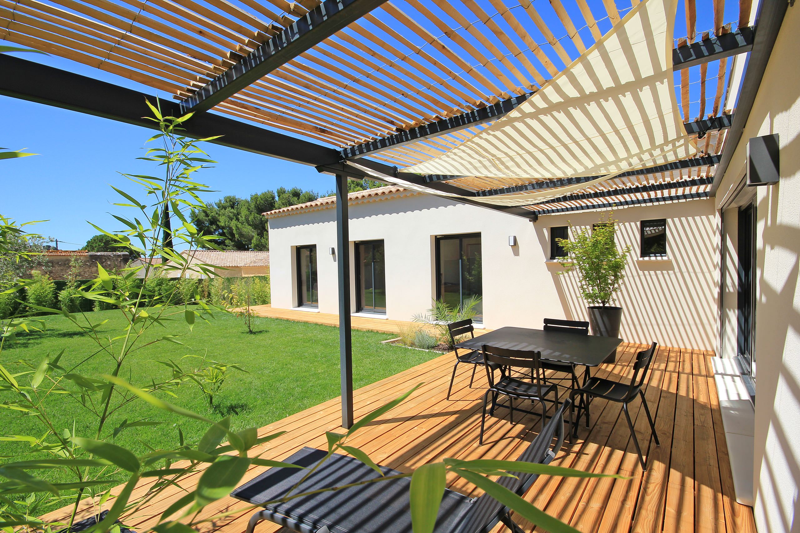16 Stunning Modern Deck Designs That Will Extend Your Home on Patio With Deck Ideas id=16056