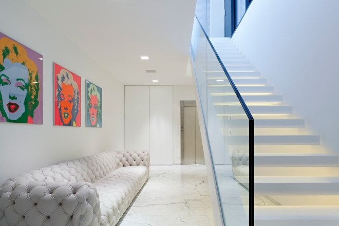 Modern staircase and white sofa in House M