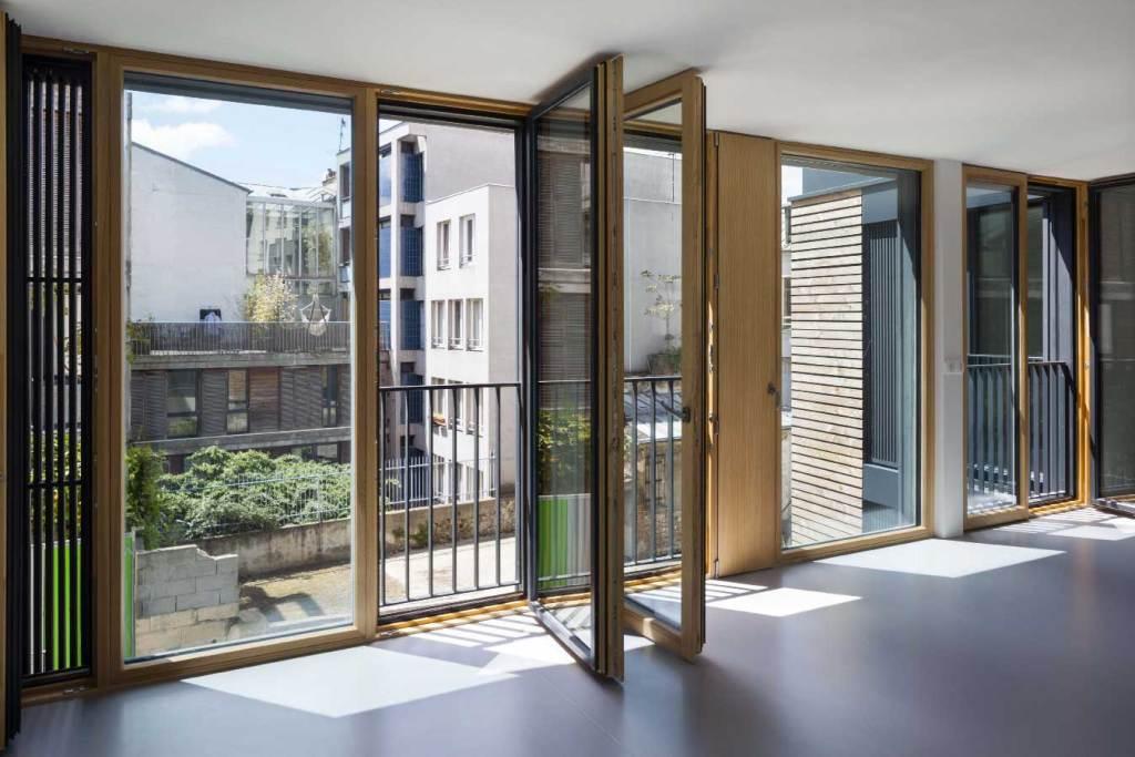 """l'aménagement intérieur du projet RIVP, 8 logements sociaux """"passifs"""" en douglas"""