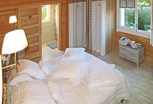 achitecture-bois-magazine-alaya-massif-chalet-arcachon-bardage-decoration-salon-poele-mezanine-interieur-hauteur-chambre