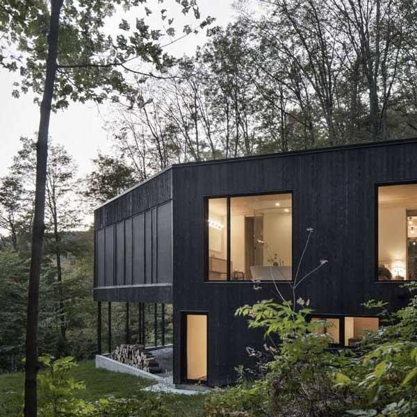 Maison bois à flanc de colline - Atelier général-bardage-pré-grisé