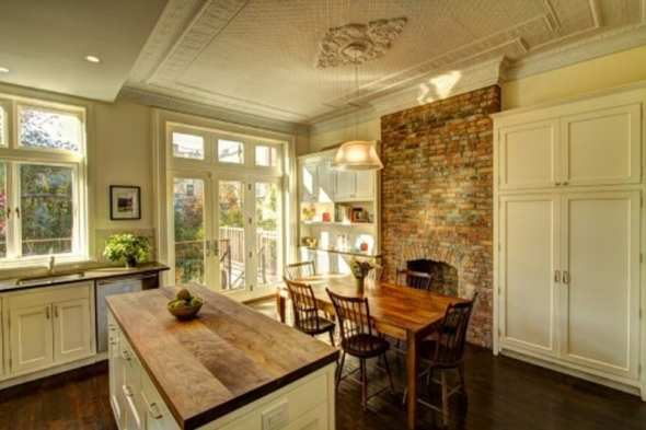 eclectic kitchen design with brick wall by new york architect Ben Herzog