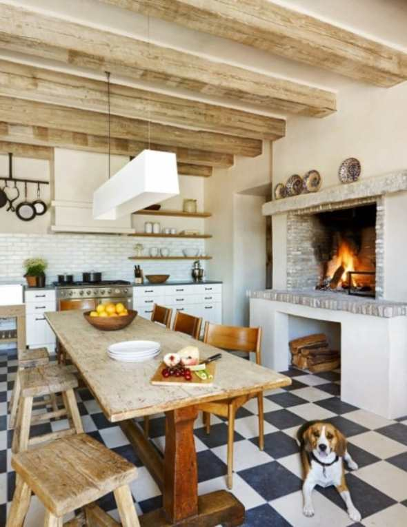 electic kitchen with wooden beams and brick  fireplace by by phoenix architect Don Ziebell