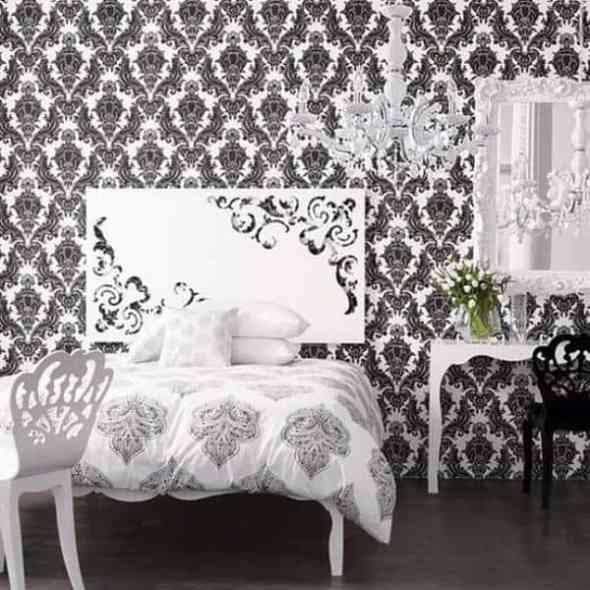 black and white vintage bedroom with crystal lamp