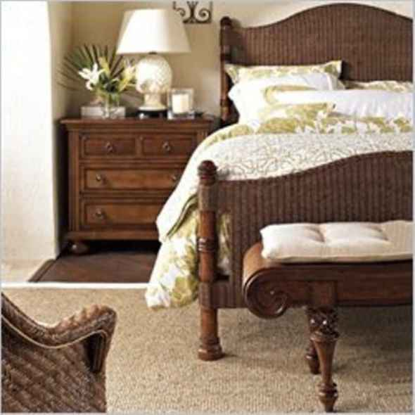 british colonial bedrrom with antique lamp and nightstands armoires
