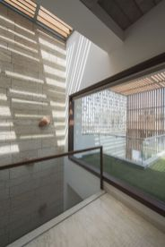 17 Natural Light penetrating from the top and flowing into spaces through triple height space