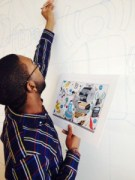 A SCAD student sketches his design on the wall of Newell Rubbermaid's new Sharpie(R) brand headquarters, which will become part of permanent art installation.