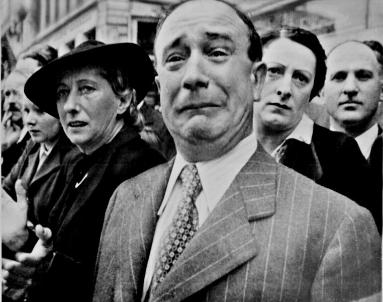 World War II Photos   National Archives A Frenchman weeps as German soldiers march into the French capital  Paris   on June 14  1940  after the Allied armies had been driven back across  France