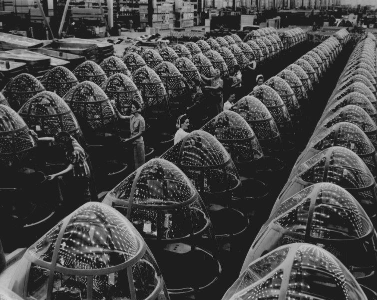 World War II Photos   National Archives Stars over Berlin and Tokyo will soon replace these factory lights  reflected in the noses of planes at Douglas Aircraft s Long Beach  Calif    plant