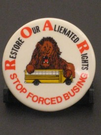 "Button of Restore Our Alienated Rights (ROAR), depicting a lion sitting on a school bus with the words, ""STOP FORCED BUSING."""