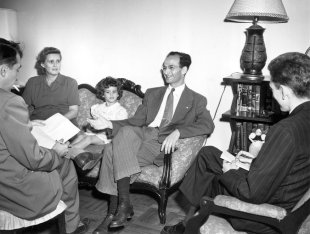 The Lorch family being interviewed in 1949 by New York Times reporters about their work in Stuyvestant Town.
