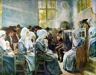A classic Quaker Meeting for Worship is happening in a large room with white walls and big windows. In the foreground, women and childen sit in prayer; the men are on the other side of the room. On the right, the front of the room, some people of both genders sit on benches, while above them hovers the transparent but recogniseable form of Jesus.