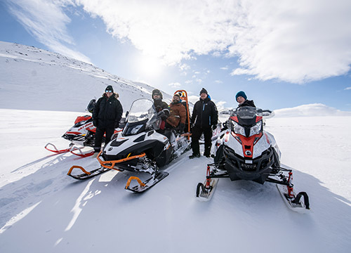 Group with snowmobiles