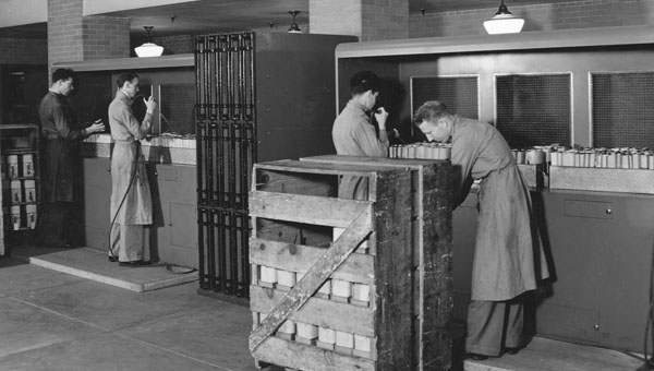 Photograph of Workers Dusting Veteran's Administration Records, 06/26/1936