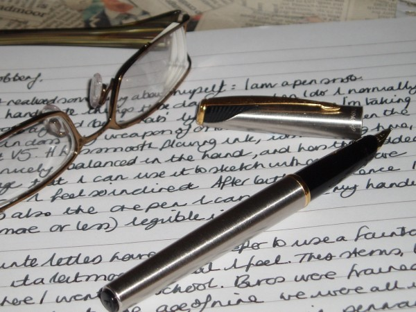 Image of correspondence with fountain pen and glasses, as an example of a low tech networking
