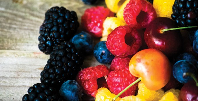 mix-of-berries-on-wooden-background